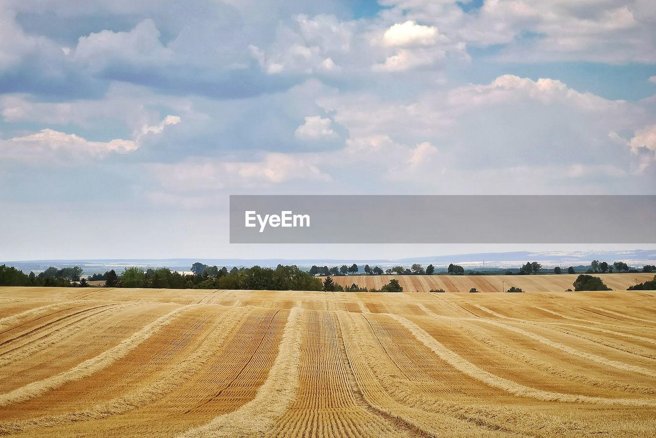 View Of Rolling Landscape Against Sky