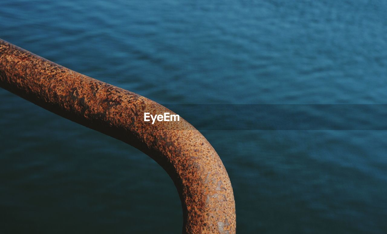 High angle view of rusty railing against river