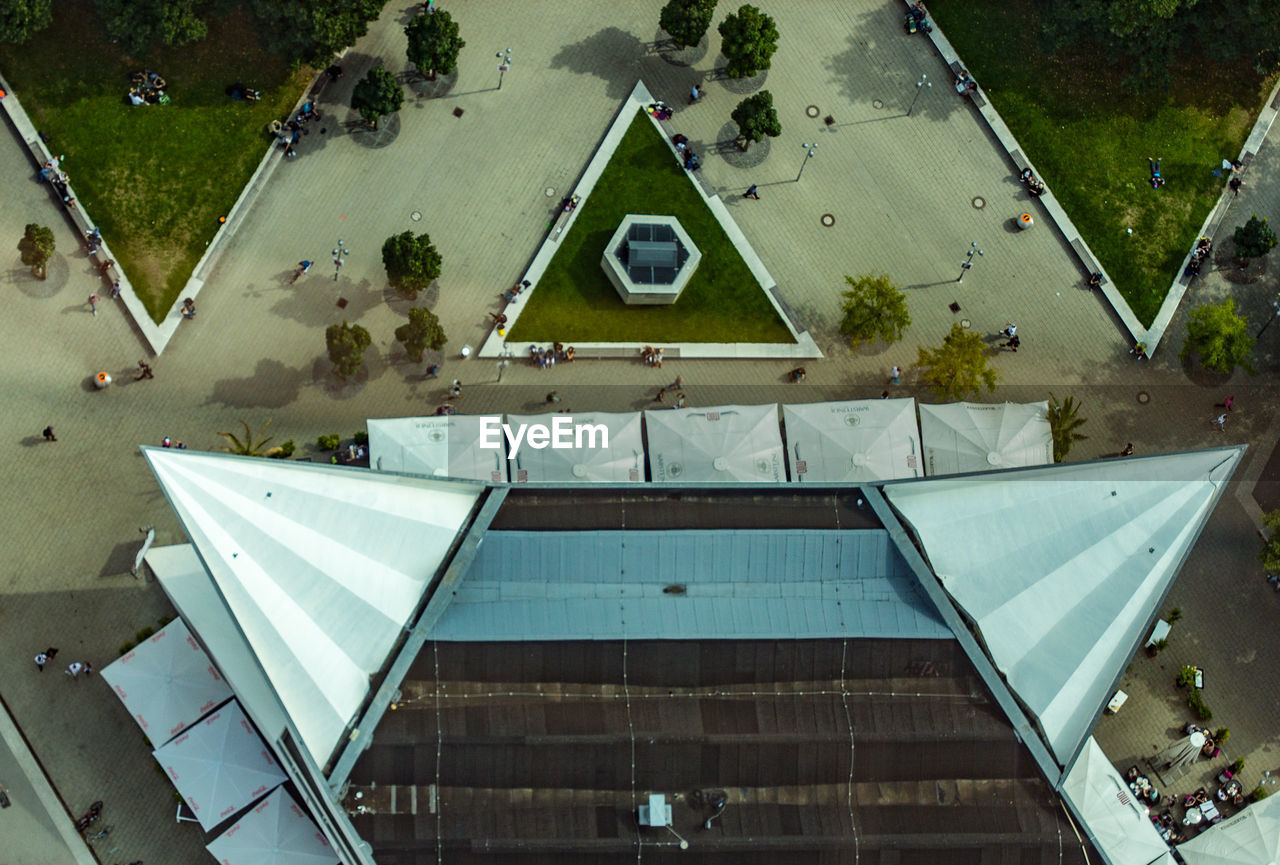 high angle view, architecture, built structure, day, pool, building exterior, plant, swimming pool, tree, no people, reflection, nature, water, outdoors, roof, city