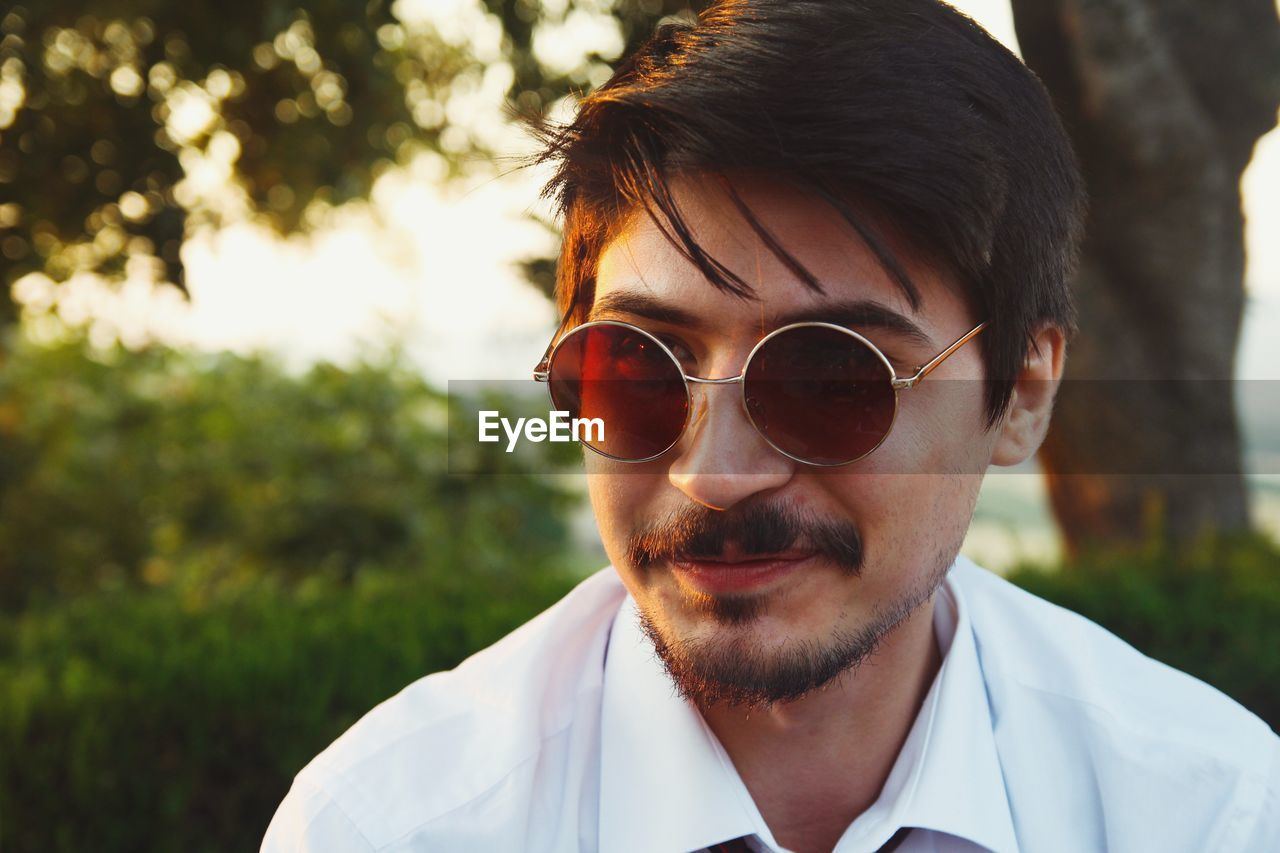 portrait, glasses, real people, sunglasses, headshot, focus on foreground, one person, front view, fashion, nature, men, beard, young men, young adult, facial hair, plant, day, outdoors, males