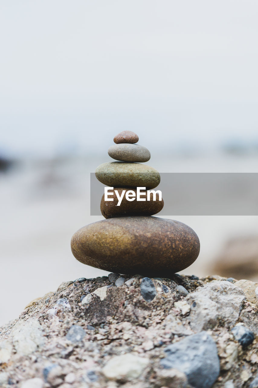 solid, rock, stone - object, stack, pebble, rock - object, balance, stone, zen-like, focus on foreground, close-up, water, no people, nature, beach, sea, land, day, sky, outdoors