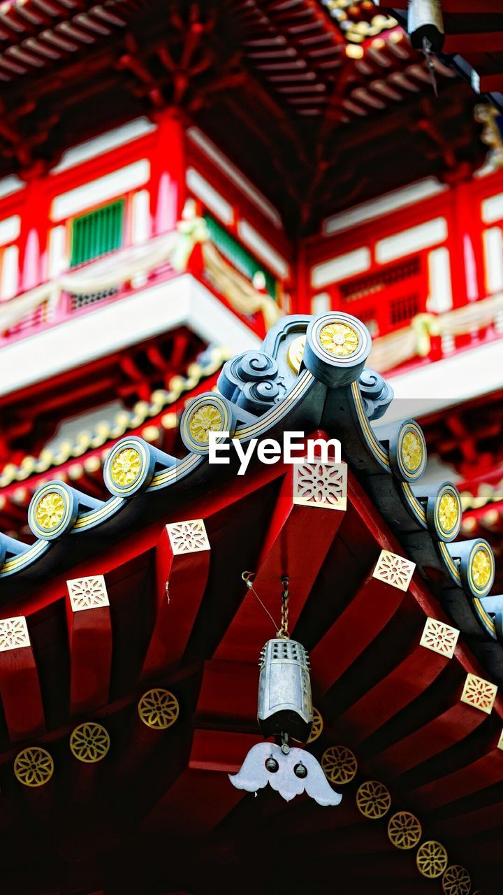 religion, lantern, spirituality, cultures, architecture, place of worship, tradition, chinese lantern, building exterior, hanging, ancient, built structure, red, ornate, history, roof, text, travel destinations, outdoors, no people, day, chinese lantern festival, low angle view, dragon, close-up