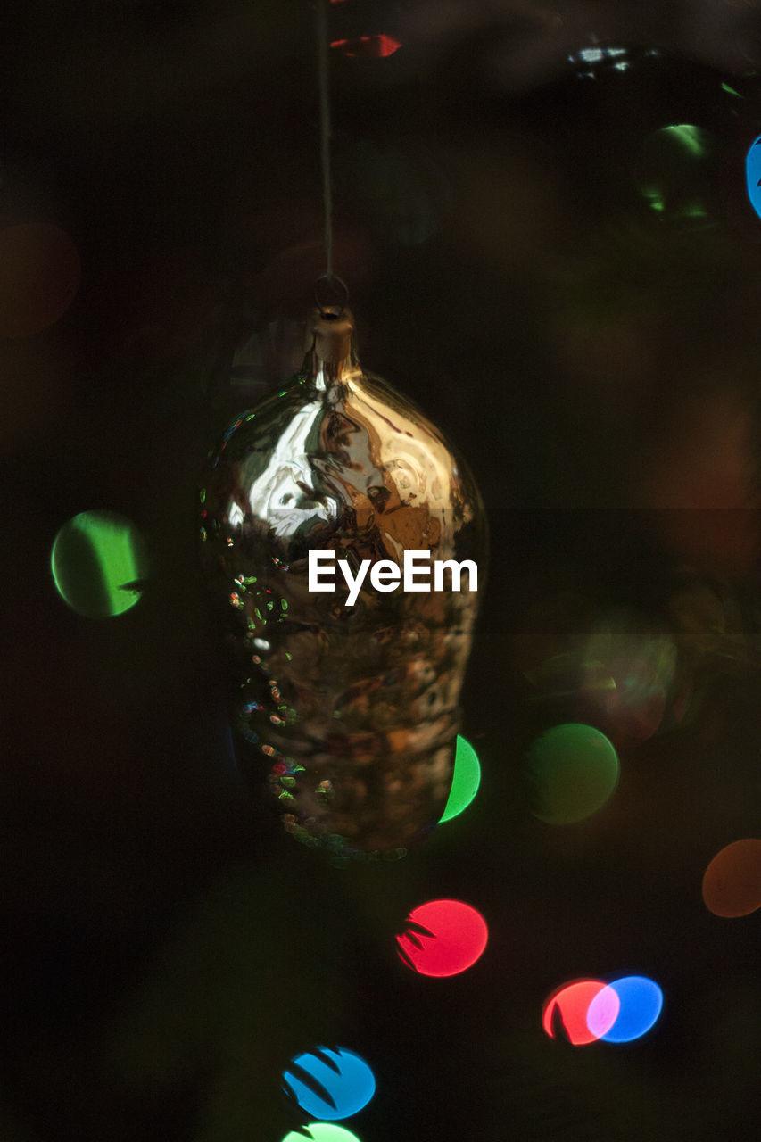 celebration, christmas, decoration, christmas decoration, christmas ornament, holiday - event, close-up, shiny, christmas tree, hanging, illuminated, night, celebration event, no people, indoors, christmas lights, multi colored, bauble