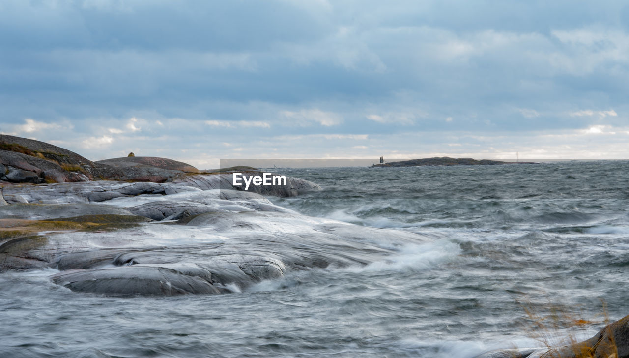 water, sky, cloud - sky, sea, motion, beauty in nature, scenics - nature, nature, waterfront, no people, day, wave, outdoors, land, tranquility, rock, sport, non-urban scene, power in nature, flowing water, marine