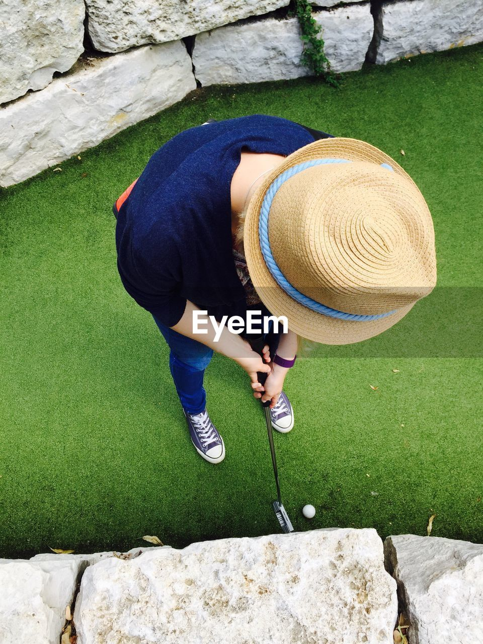 High Angle View Of Woman Playing Golf