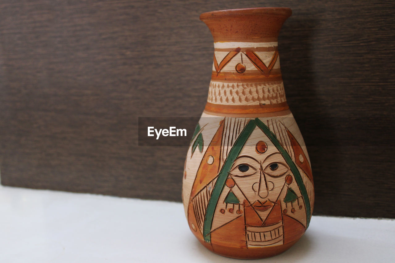 Close-up of vase on table