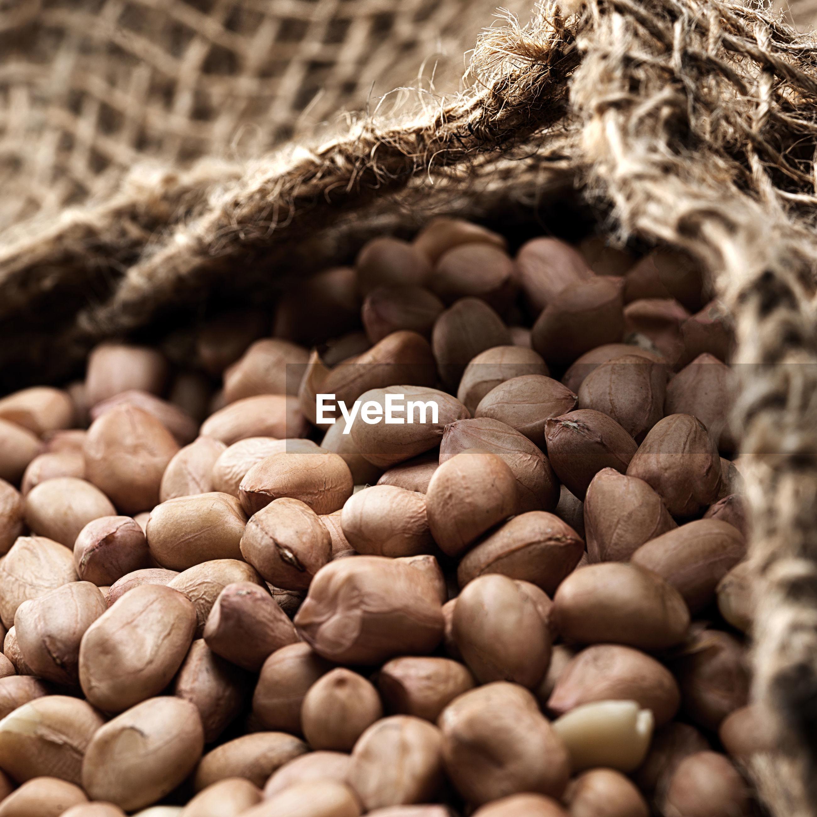 Close-up of peanuts in jute sack