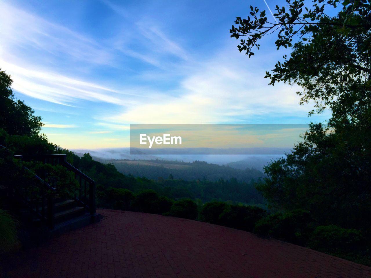 Silhouette landscape against the sky