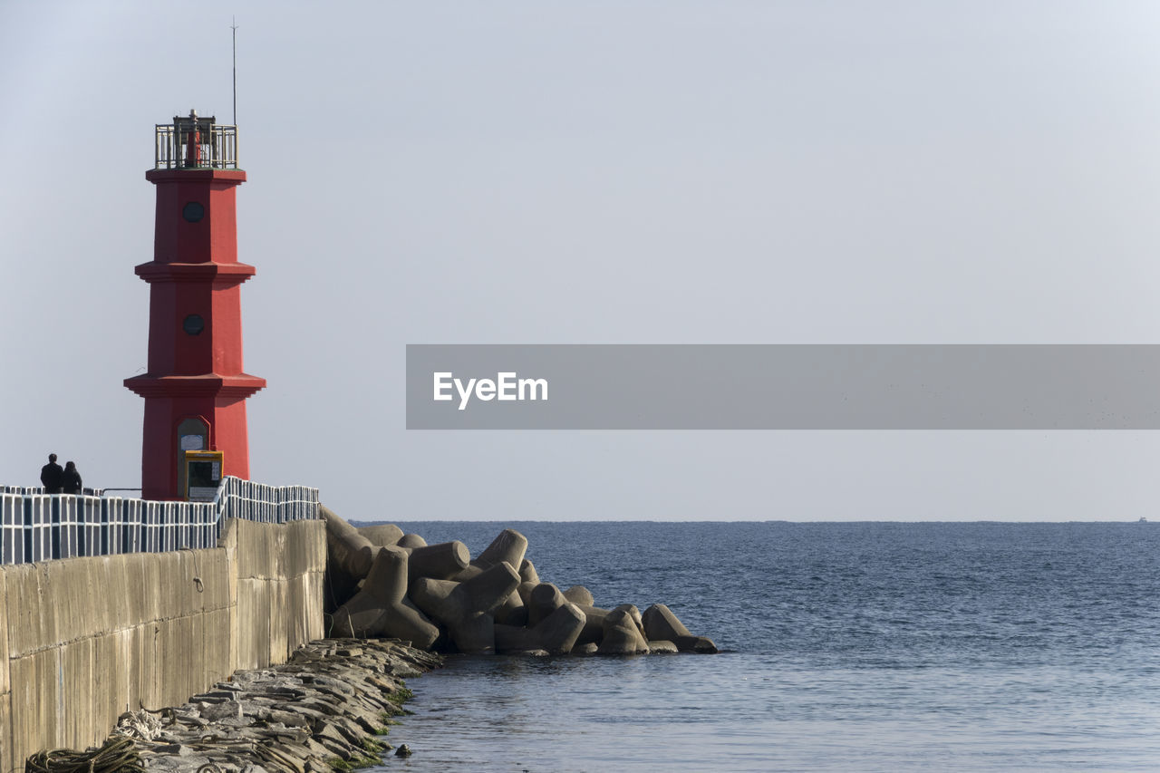 water, sea, sky, guidance, built structure, horizon over water, architecture, horizon, nature, copy space, tower, lighthouse, protection, security, clear sky, direction, safety, beauty in nature, building exterior, no people, groyne