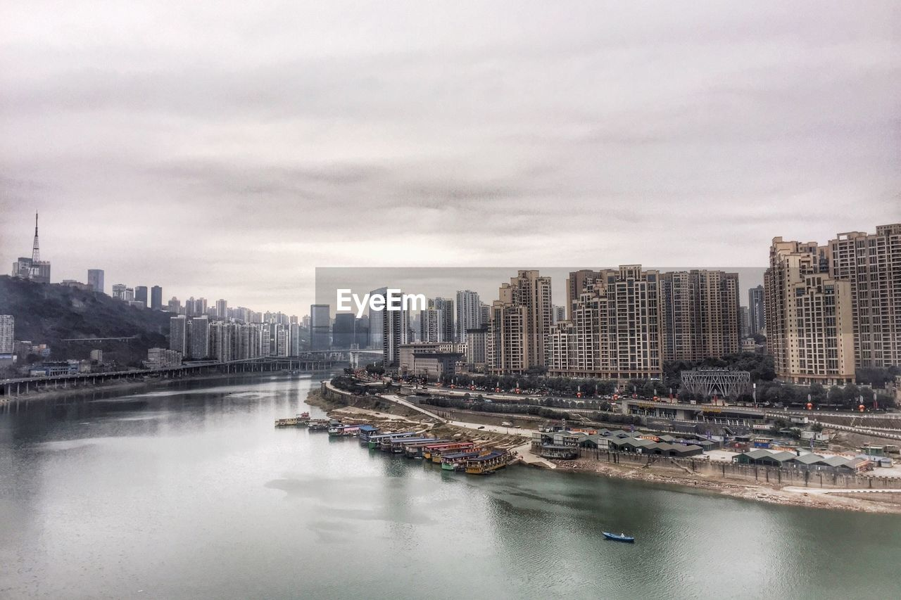 architecture, city, building exterior, skyscraper, built structure, cityscape, modern, skyline, water, no people, downtown district, sky, outdoors, urban skyline, day, nautical vessel