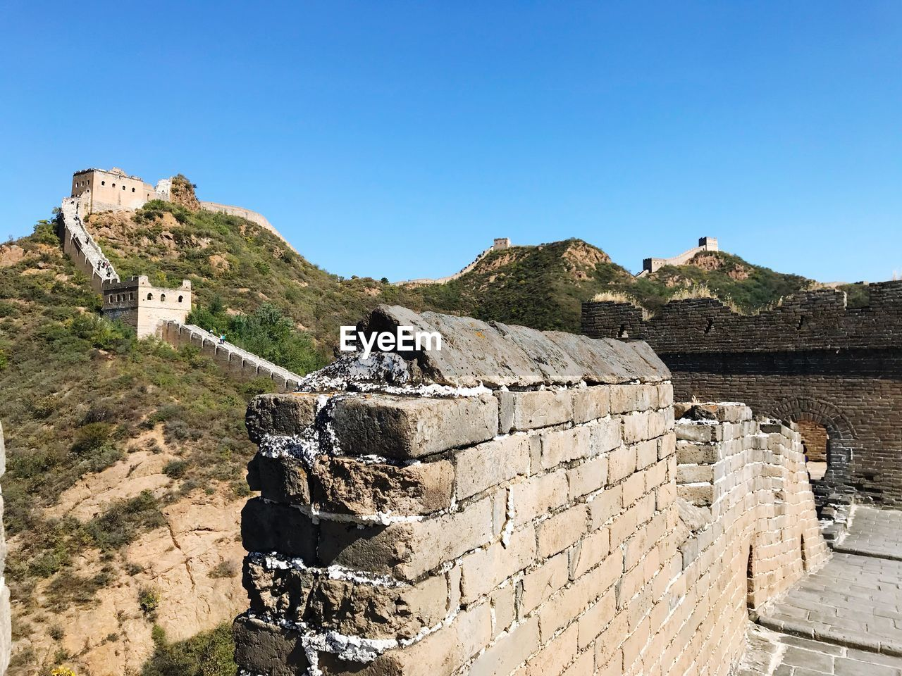 sky, architecture, history, the past, built structure, ancient, nature, clear sky, building exterior, day, travel destinations, wall, old ruin, tourism, blue, travel, mountain, sunlight, no people, copy space, fort, ancient civilization, outdoors, stone wall, ruined