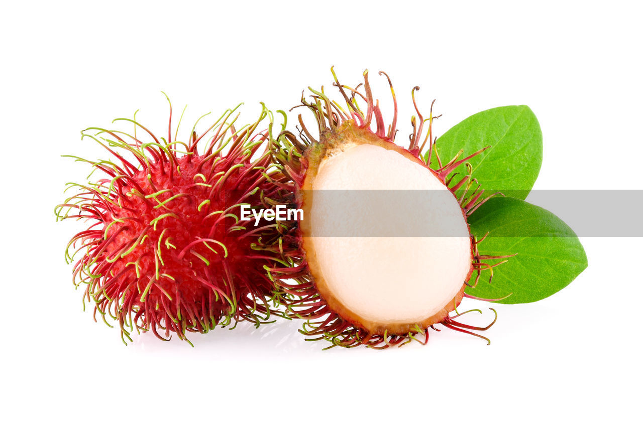 white background, studio shot, healthy eating, freshness, wellbeing, food and drink, cut out, fruit, close-up, food, still life, indoors, no people, plant part, leaf, green color, nature, orange color, organic, red, ripe, lychee