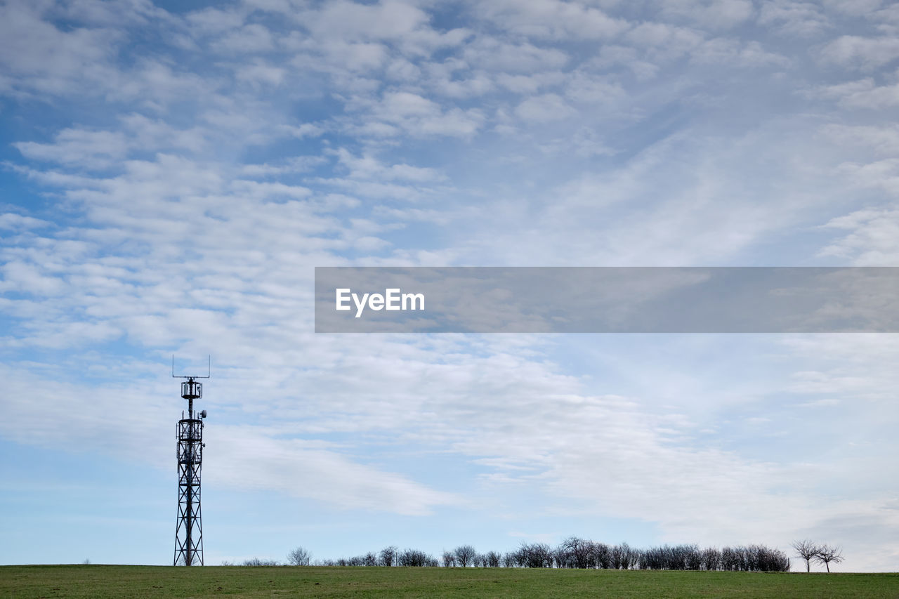cloud - sky, sky, technology, land, no people, field, day, nature, connection, fuel and power generation, electricity, beauty in nature, low angle view, environment, landscape, electricity pylon, plant, tranquil scene, scenics - nature, outdoors, global communications, power supply, radio wave