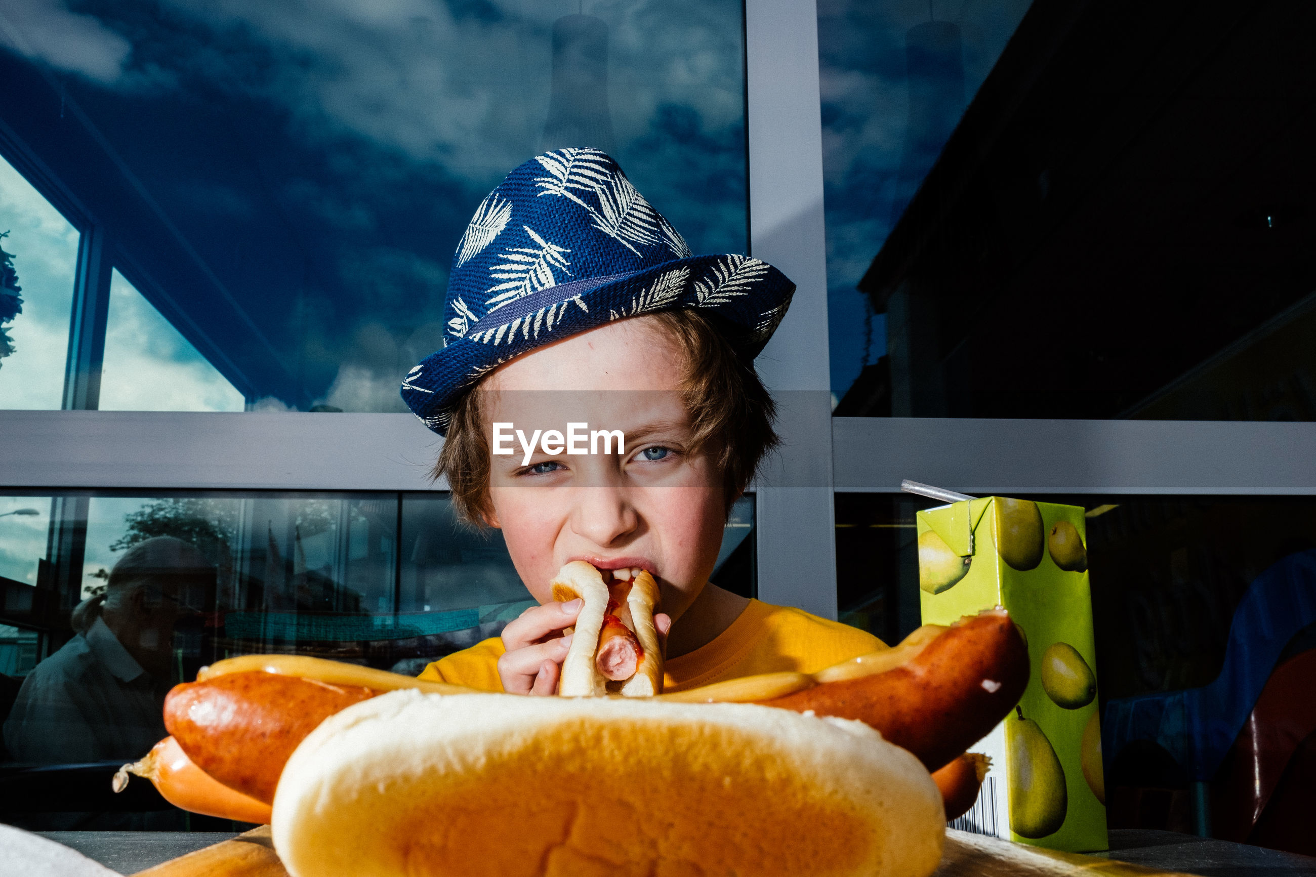 Portrait of boy eating hot dog