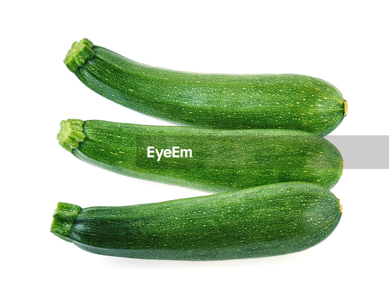 Close-up of cucumbers against white background