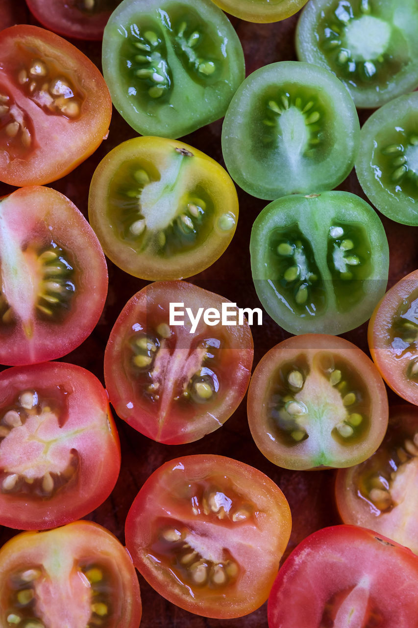 Full Frame Shot Of Tomato Slices Arranged On Table