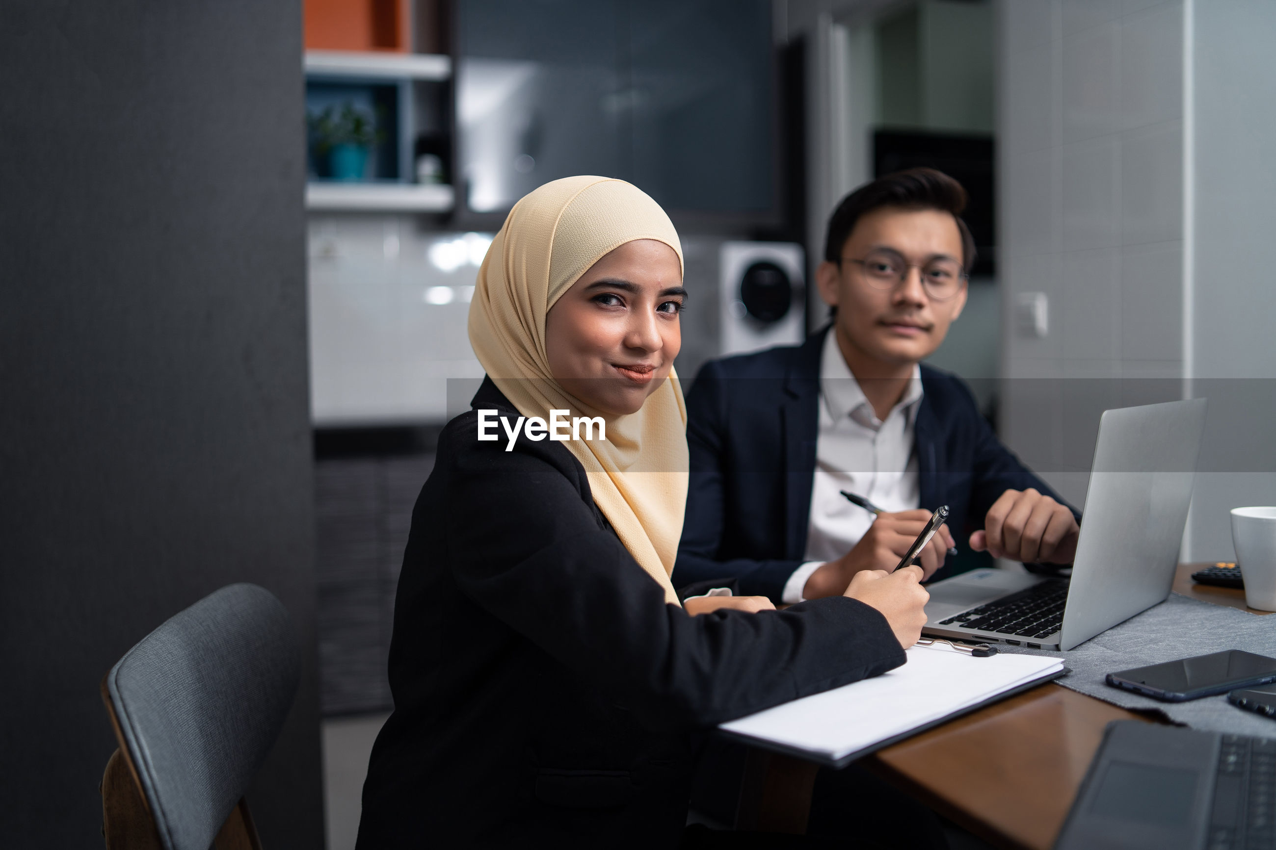 Business people working at desk in office cafeteria