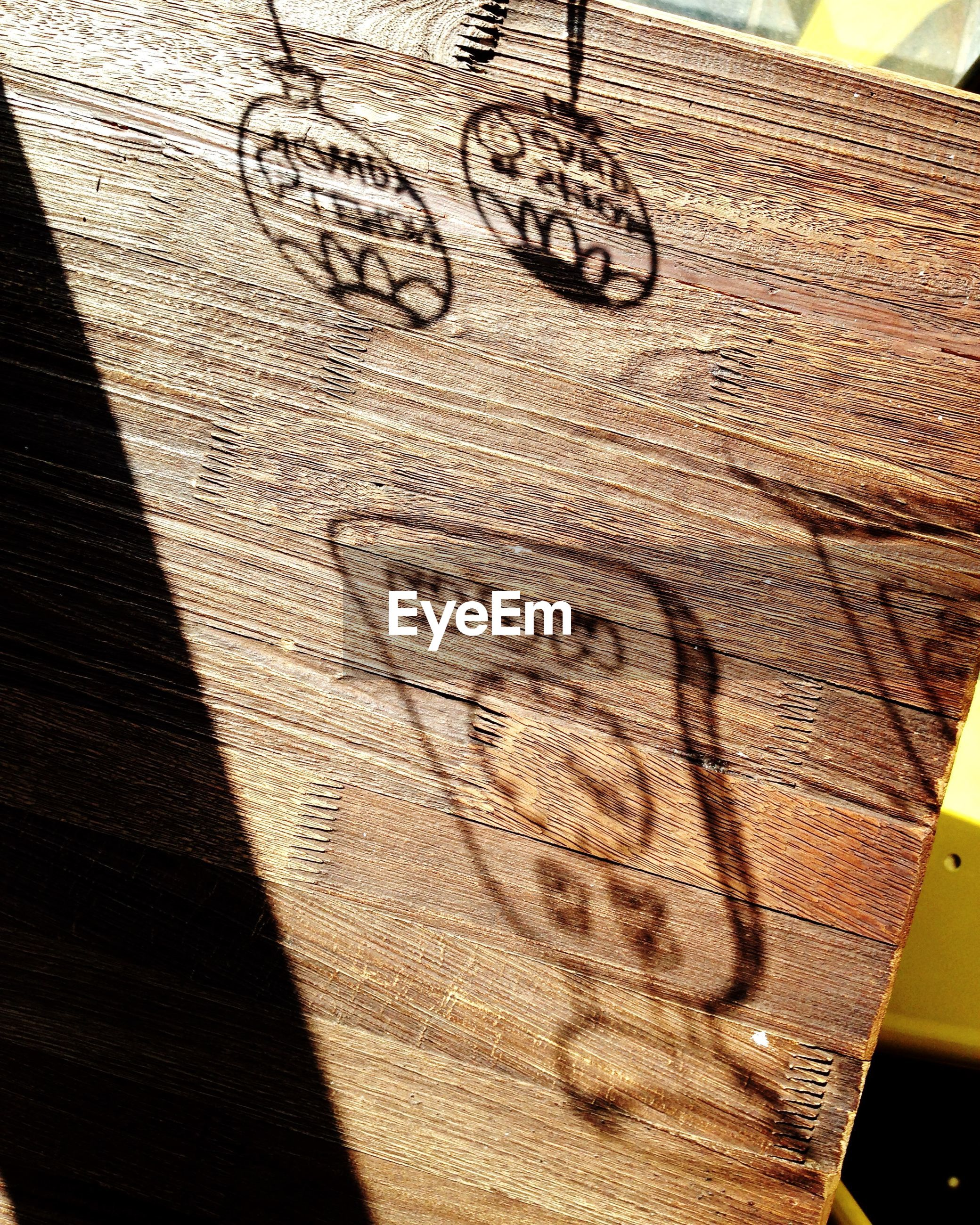 High angle view of drawing on wooden table