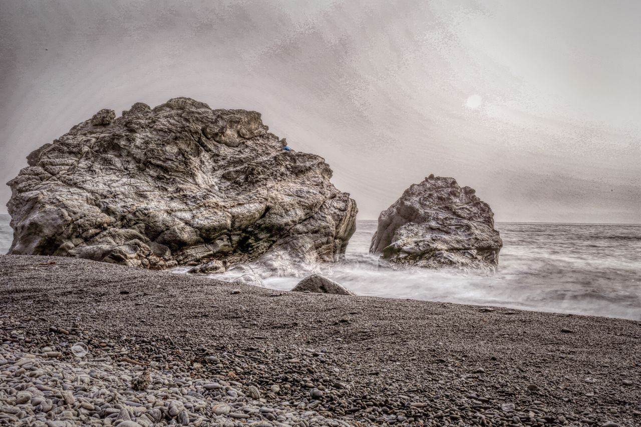 rock, rock - object, solid, land, sea, water, rock formation, beach, beauty in nature, tranquility, nature, tranquil scene, no people, scenics - nature, motion, sky, day, non-urban scene, outdoors, stack rock, eroded