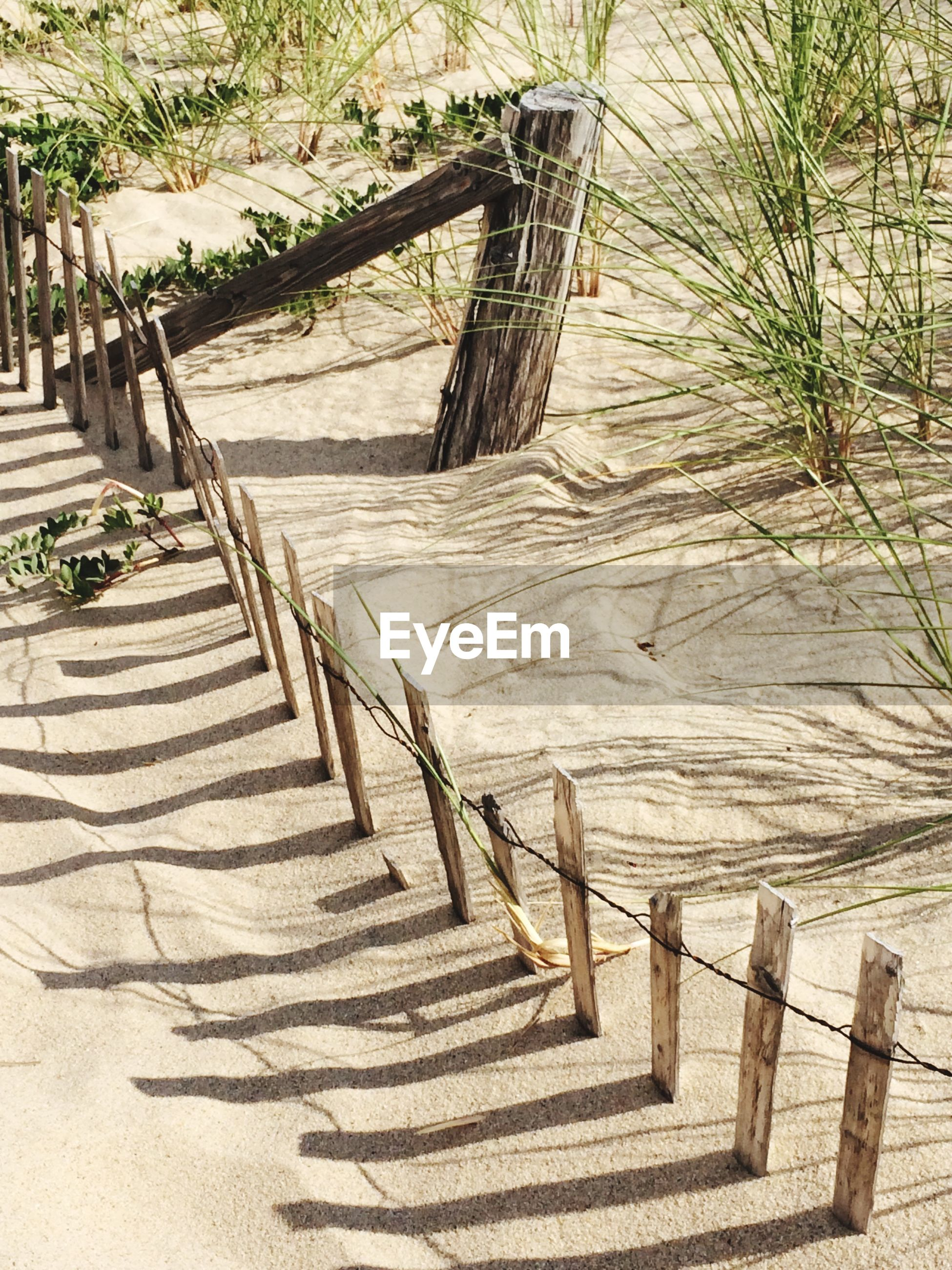 High angle view of fence at beach