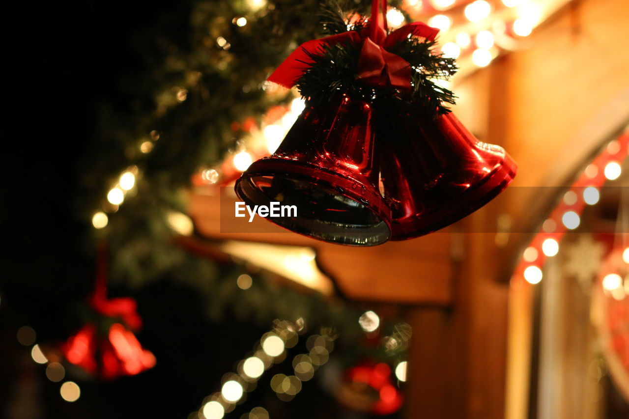 Close-up of bell shape christmas decoration at night