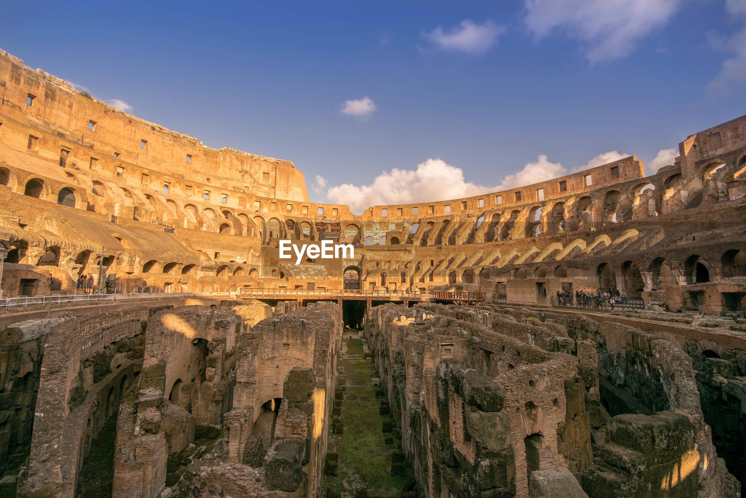 Ruined coliseum against sky