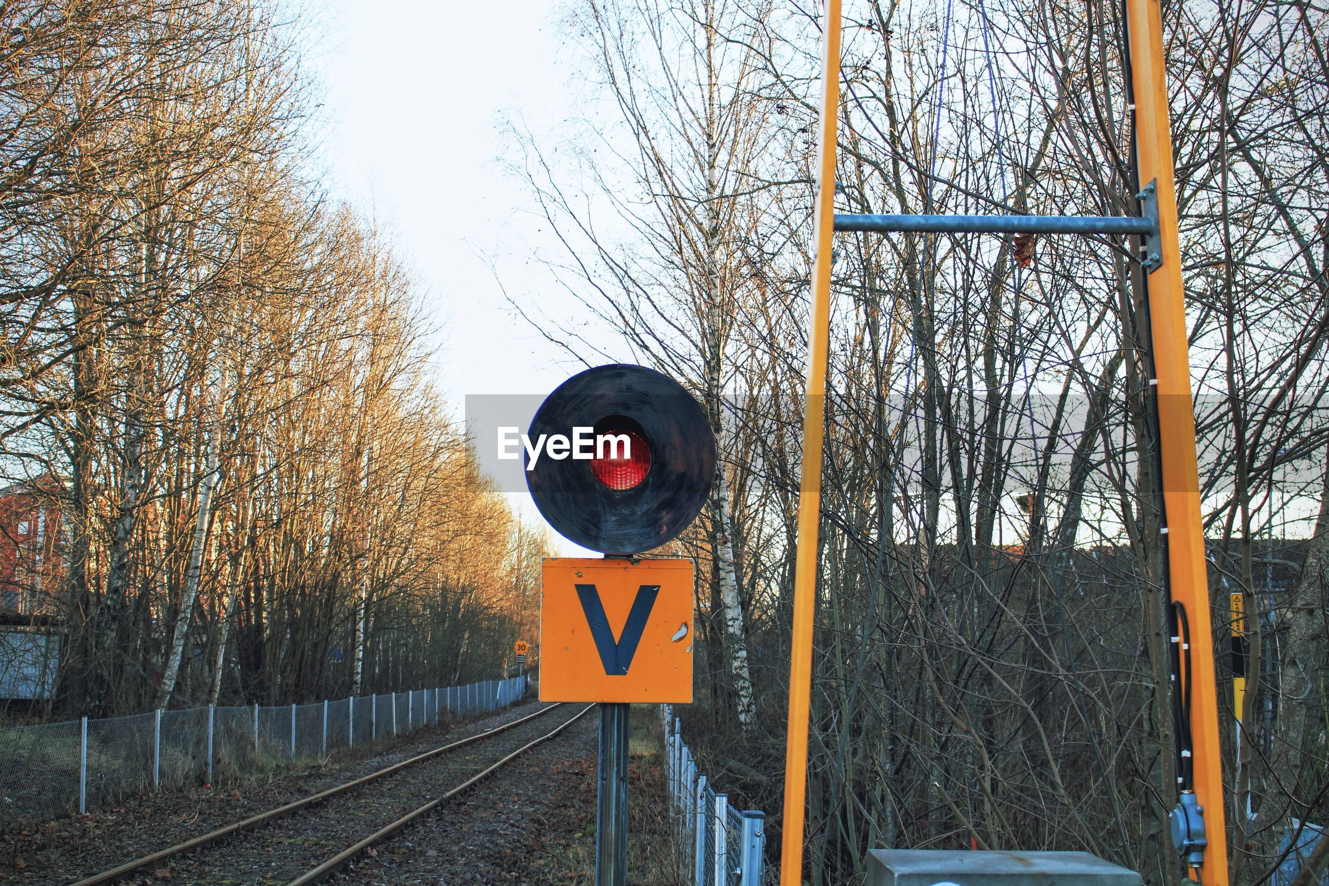 Warning sign on railroad track