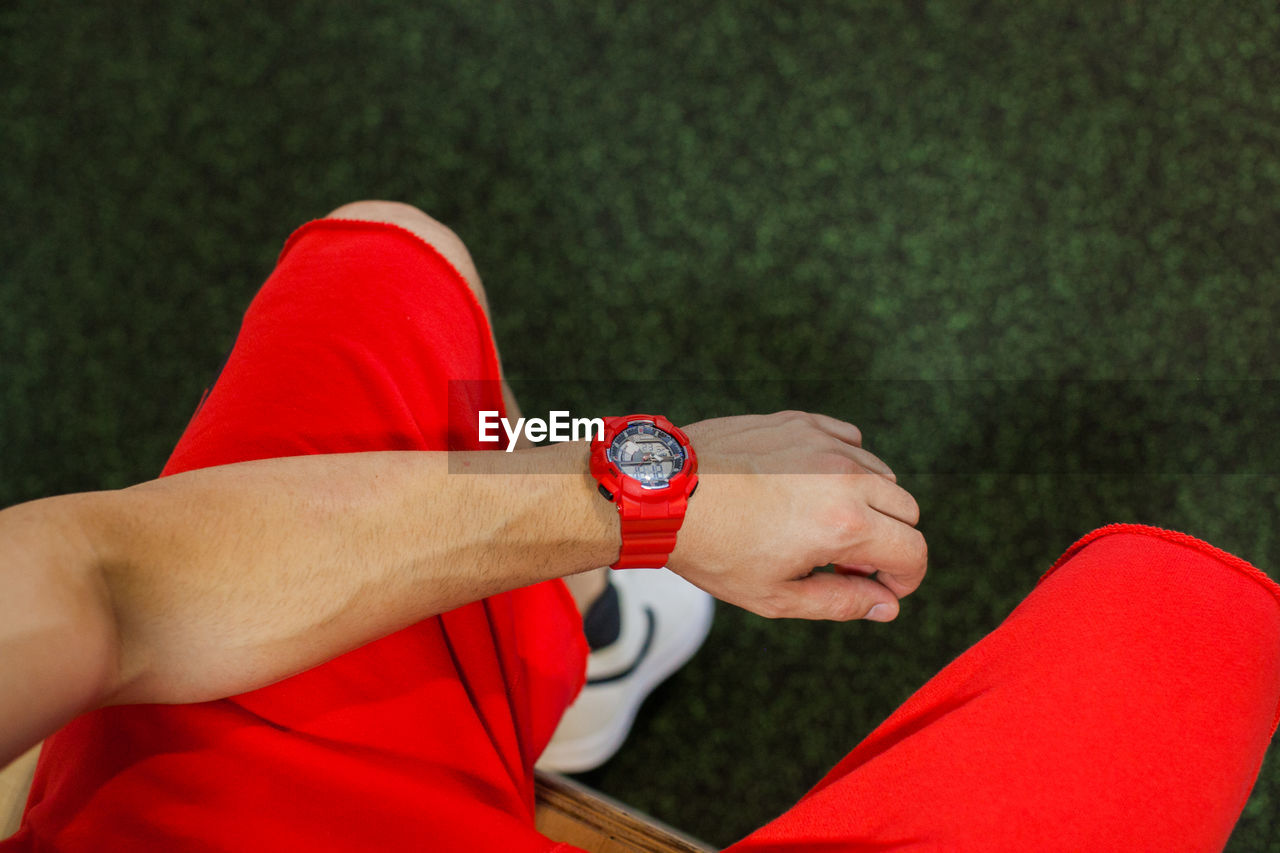Low Section Of Man Wearing Wristwatch