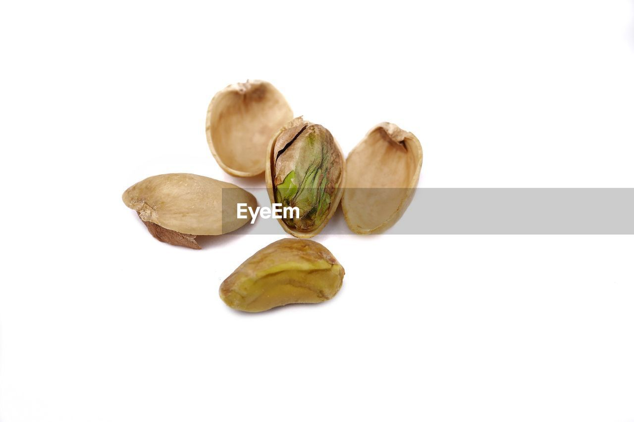 studio shot, white background, still life, group of objects, wellbeing, healthy eating, food and drink, food, indoors, freshness, copy space, close-up, cut out, no people, fruit, nut, medium group of objects, nut - food, high angle view, brown, snack, dieting