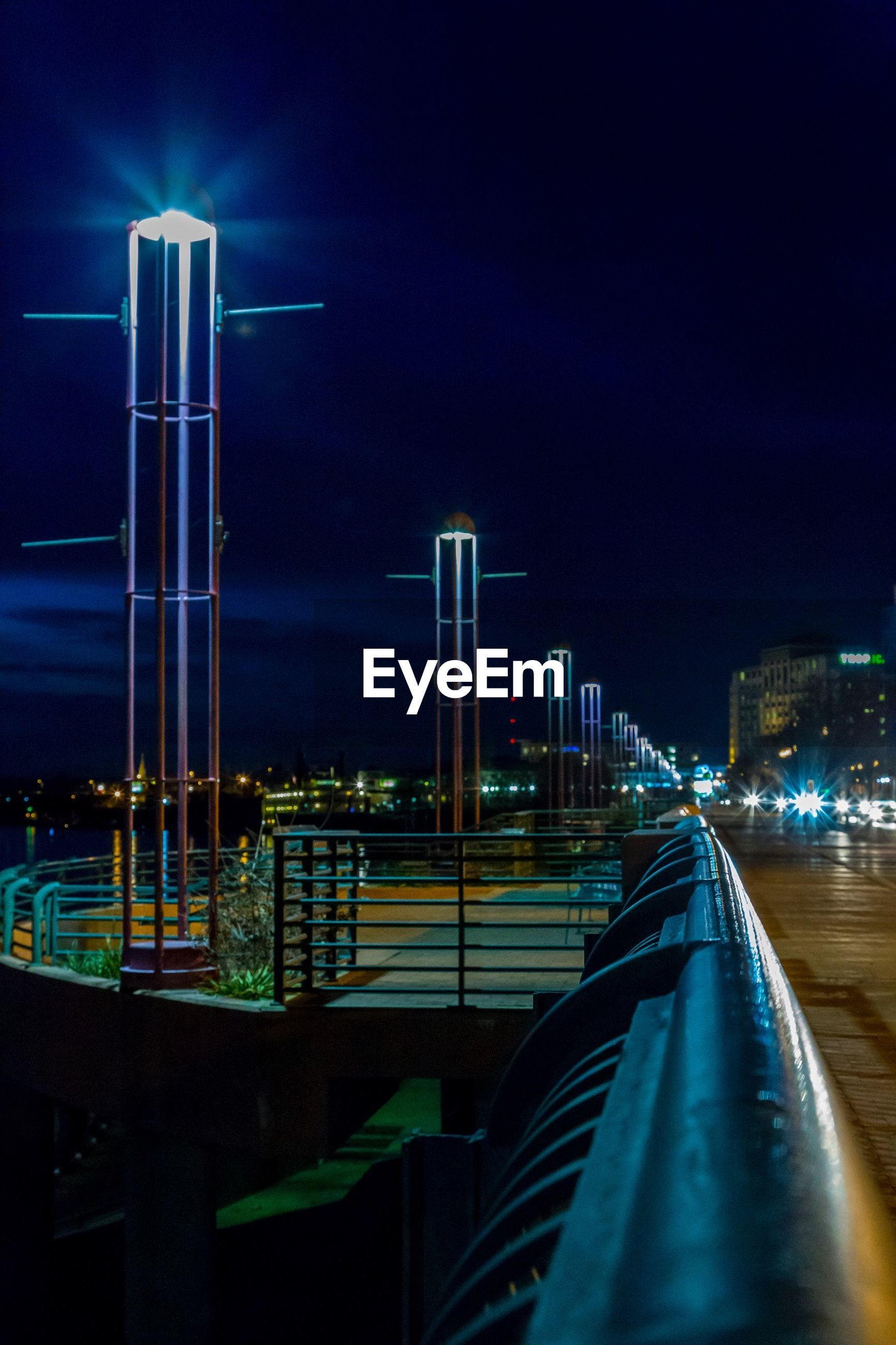 illuminated, night, architecture, built structure, building exterior, city, transportation, sky, bridge - man made structure, blue, modern, street light, lighting equipment, copy space, connection, river, skyscraper, engineering, capital cities, travel destinations