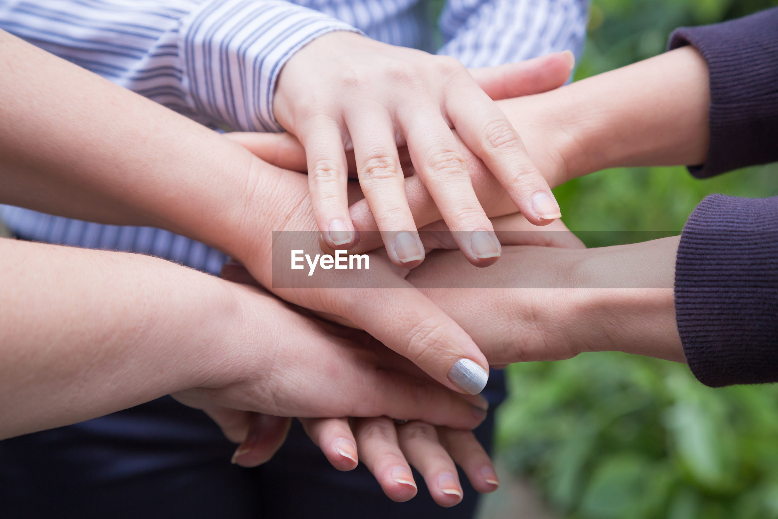 Cropped image of hands gathered in unity