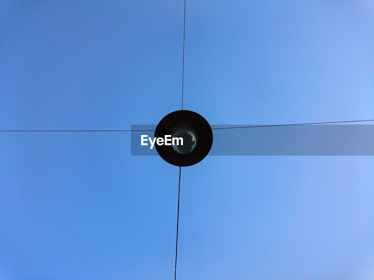 blue, low angle view, cable, lighting equipment, hanging, electricity, no people, day, technology, outdoors, clear sky