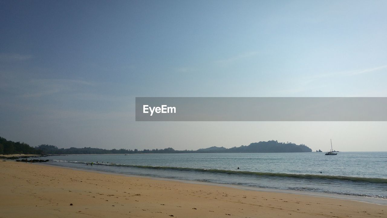 sea, beach, water, sand, scenics, shore, beauty in nature, sky, nature, tranquility, tranquil scene, outdoors, nautical vessel, horizon over water, no people, day