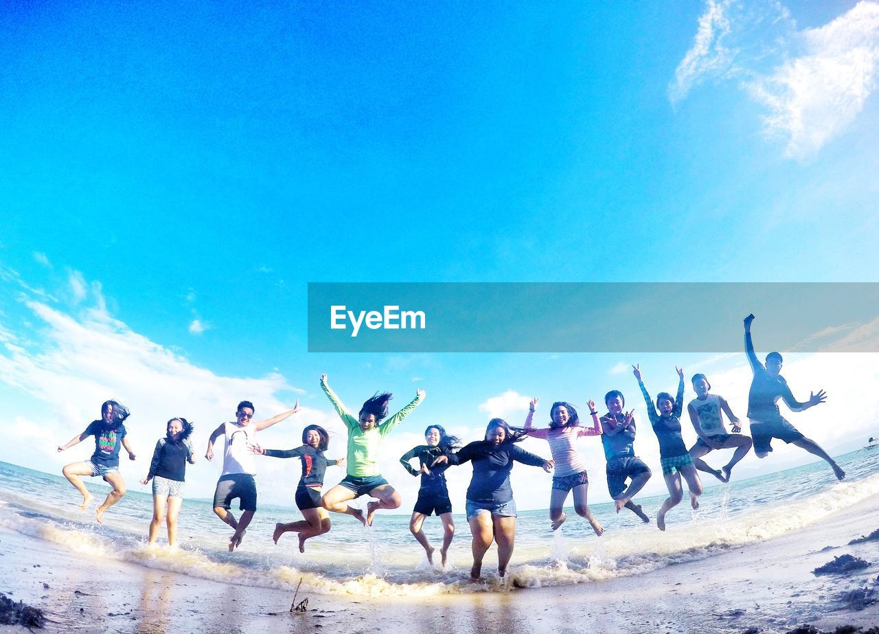 men, beach, large group of people, sky, day, water, blue, sea, outdoors, nature, sand, real people, large group of animals, beauty in nature, lifestyles, full length, togetherness, women, people