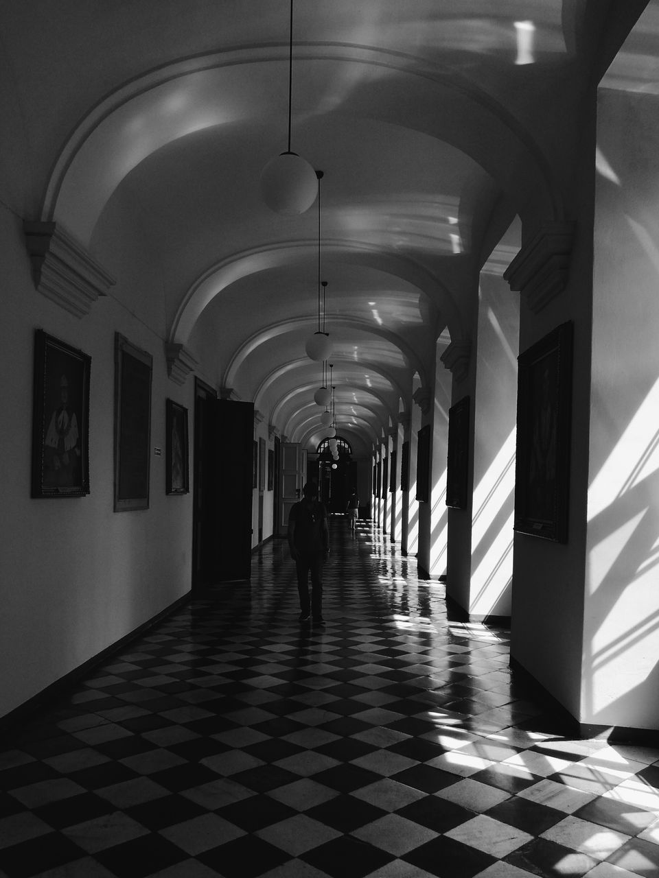 arch, corridor, indoors, the way forward, ceiling, architecture, real people, built structure, full length, illuminated, architectural column, one person, day
