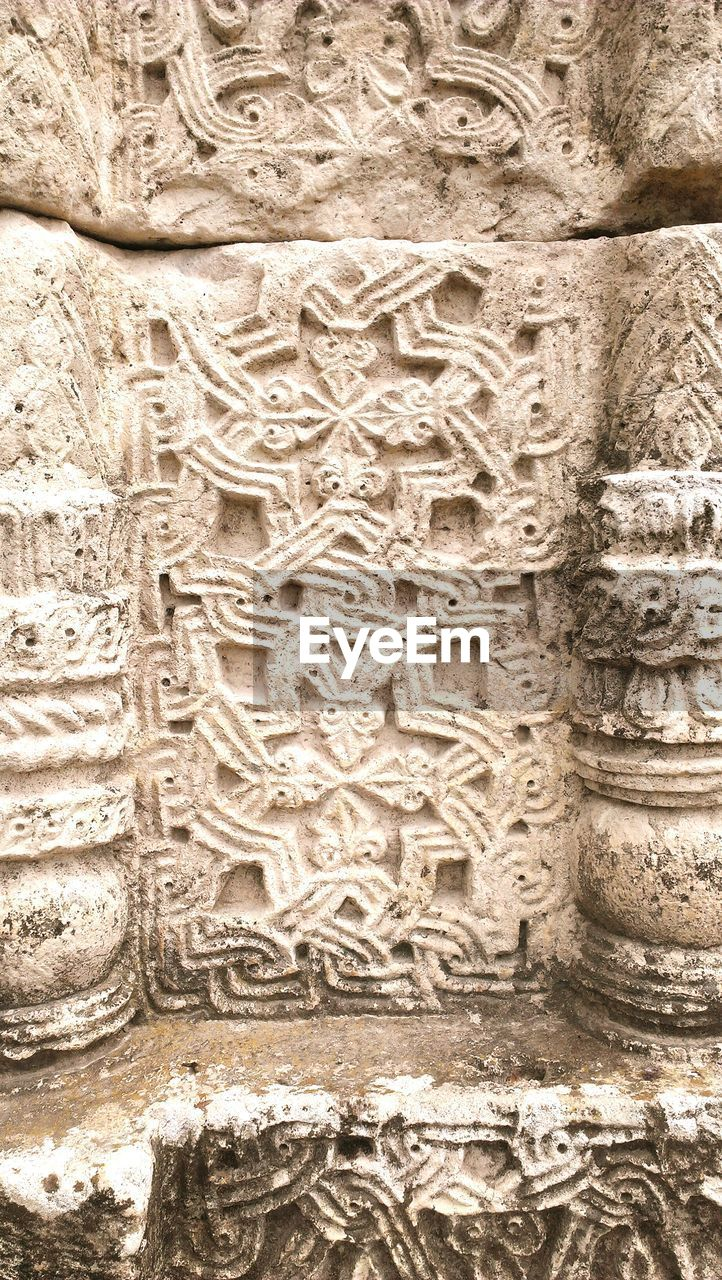 bas relief, ancient, carving - craft product, history, human representation, stone material, sculpture, religion, full frame, no people, ancient civilization, statue, spirituality, close-up, backgrounds, built structure, place of worship, architecture, day, outdoors