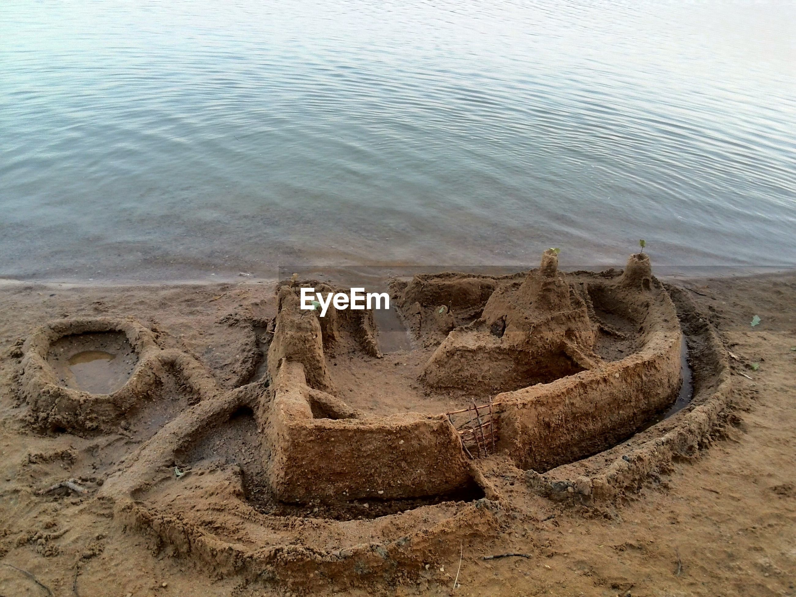 High angle view of sand castle on shore