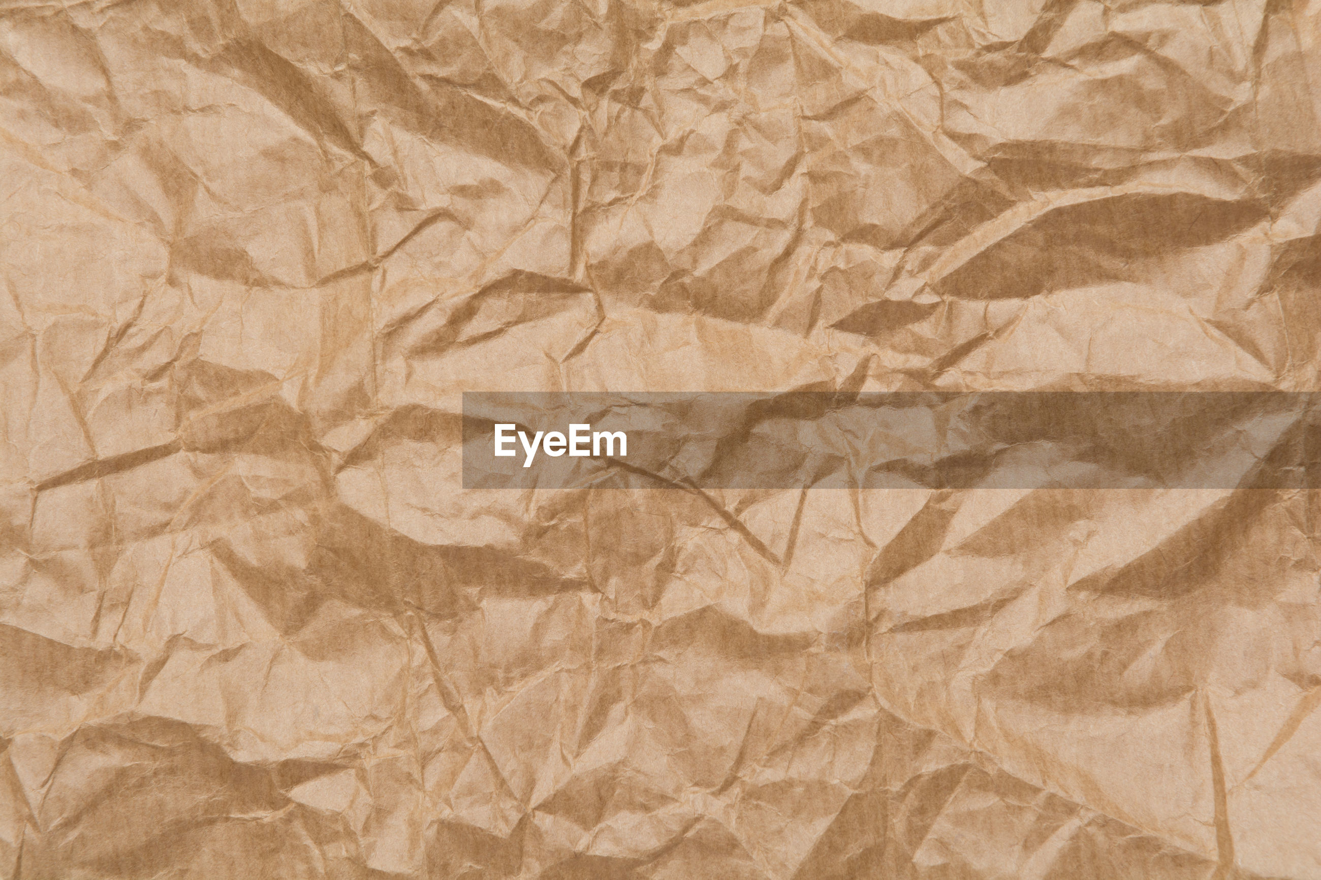 Full frame shot of crumpled brown paper