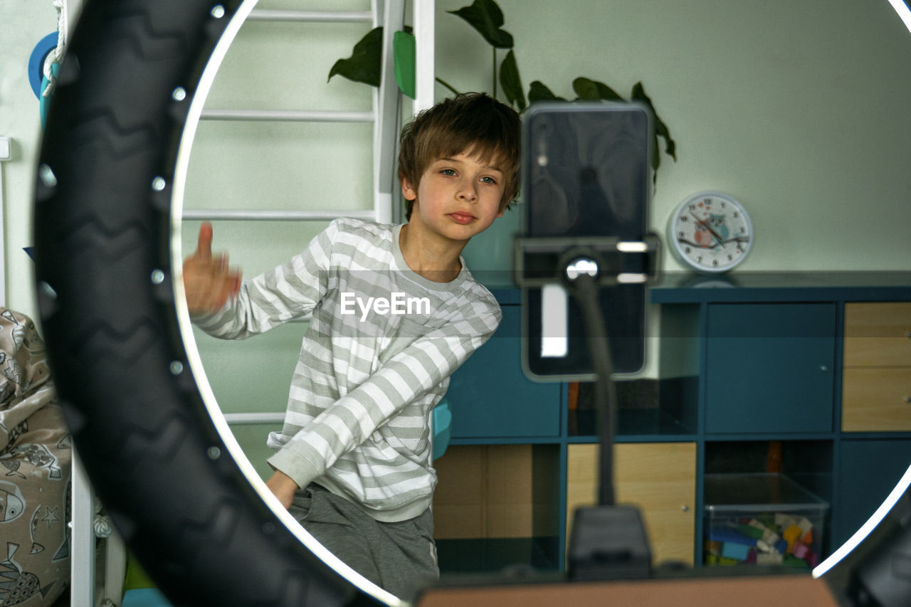 PORTRAIT OF CUTE BOY PLAYING IN THE ROOM