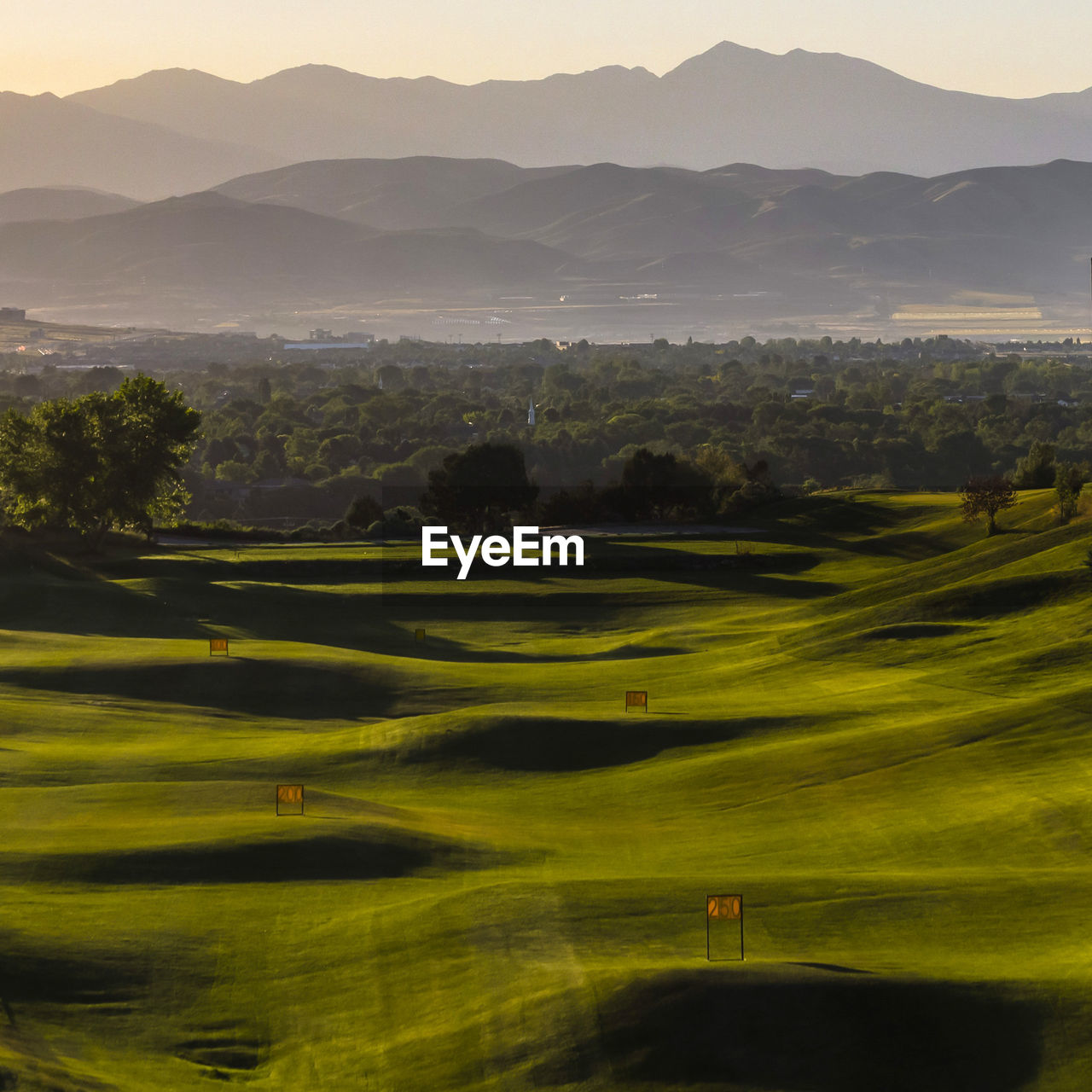 scenics - nature, green color, mountain, beauty in nature, golf course, landscape, plant, environment, tranquility, tranquil scene, golf, grass, no people, nature, sky, day, non-urban scene, tree, activity, sport, mountain range, green - golf course, outdoors, rolling landscape