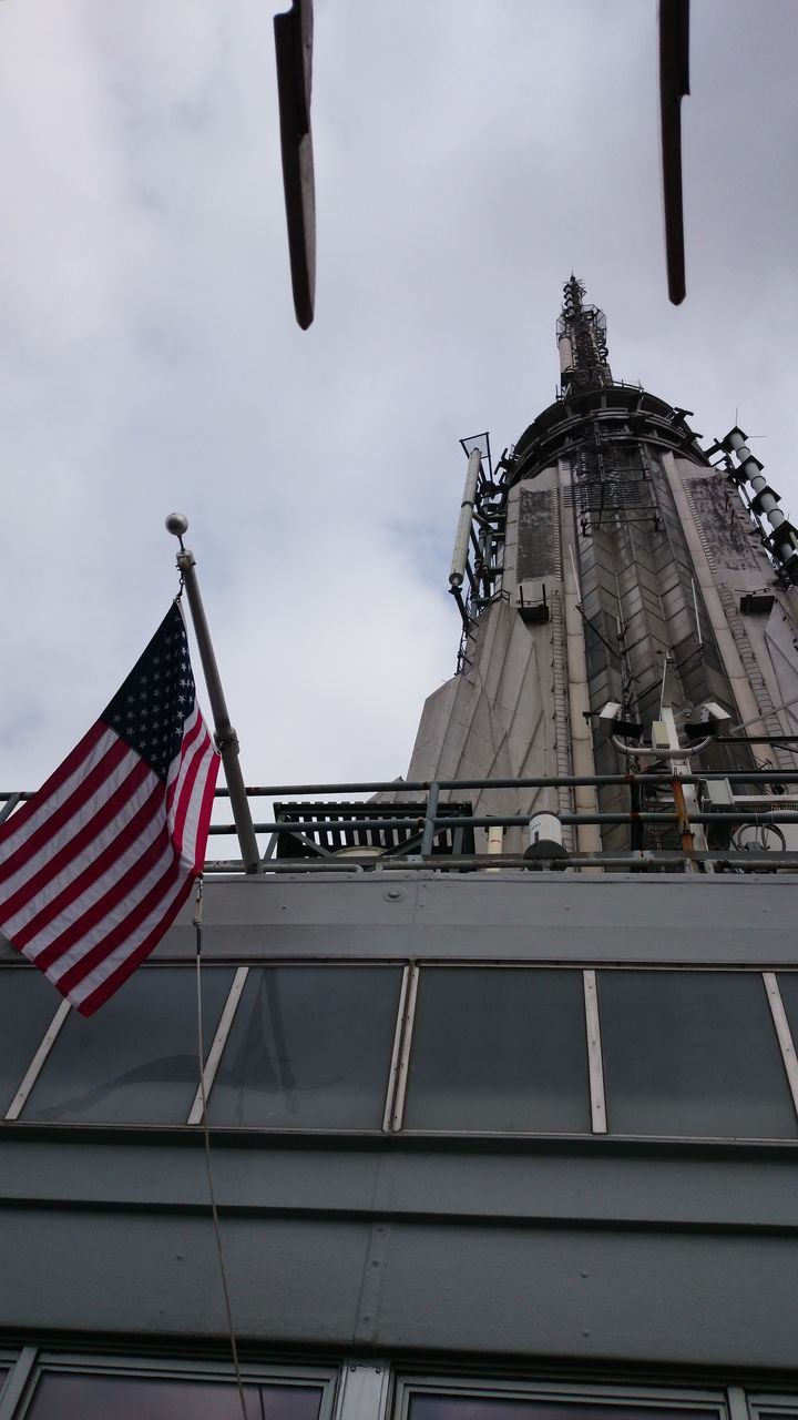 flag, patriotism, architecture, striped, low angle view, stars and stripes, built structure, no people, outdoors, building exterior, day, sky, flying