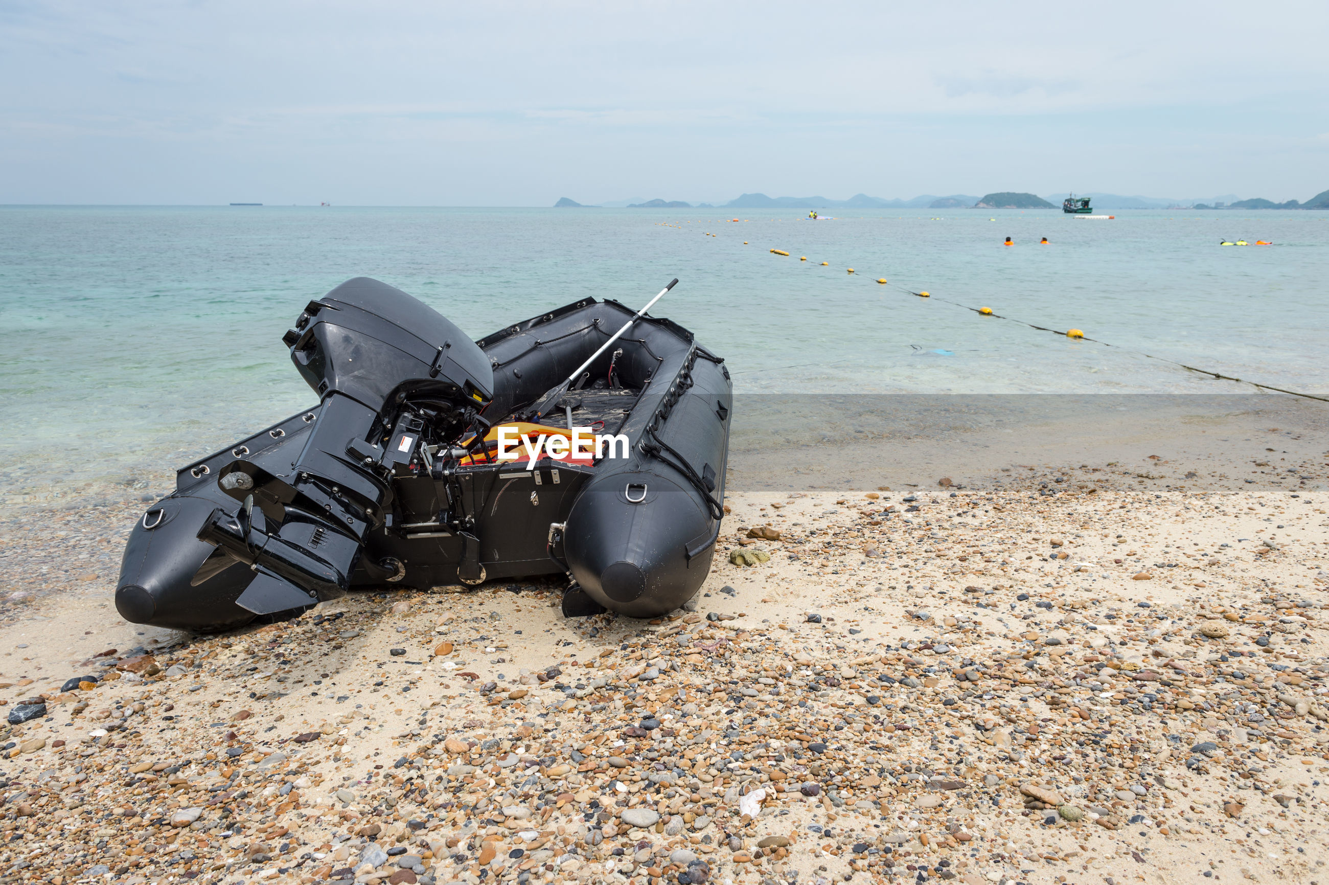 MOTORCYCLE ON SHORE AT BEACH