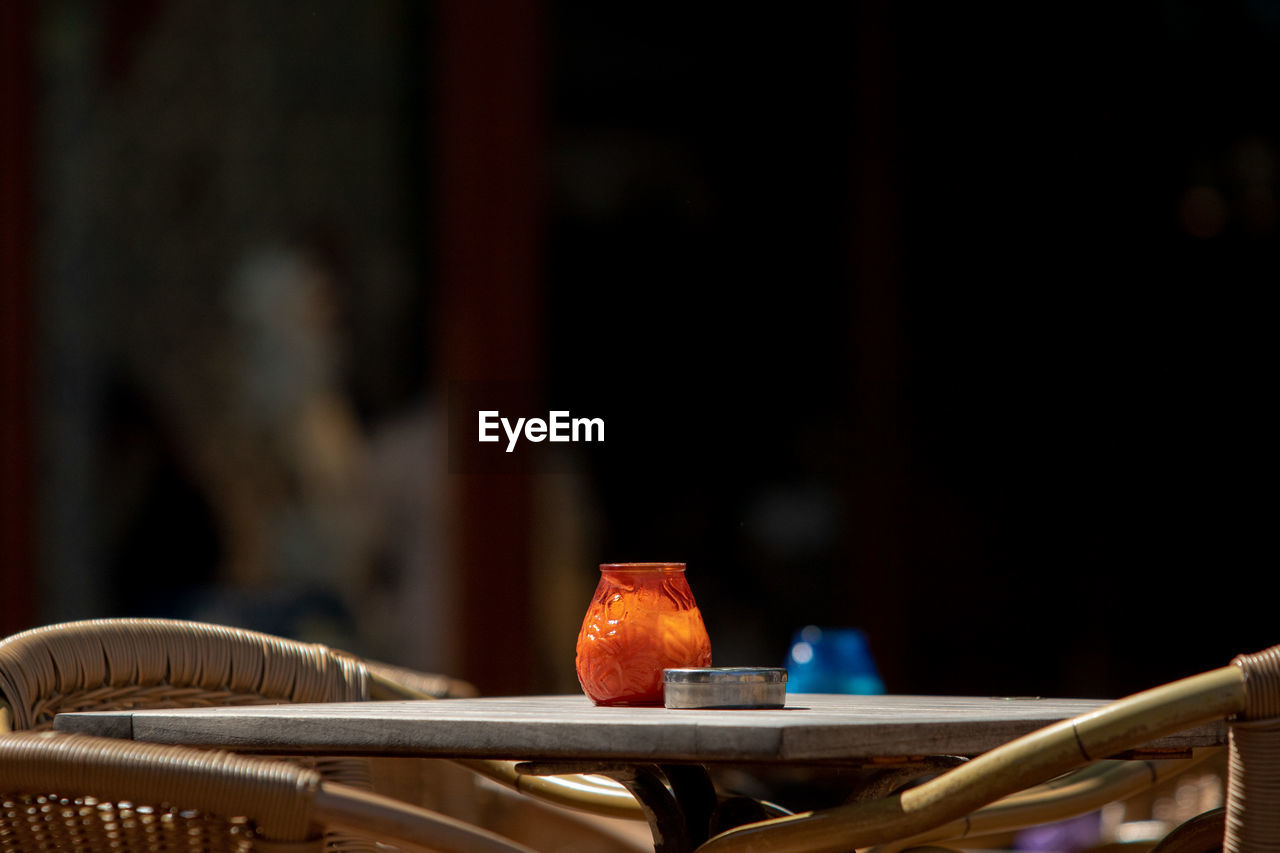 indoors, focus on foreground, close-up, table, orange color, no people, selective focus, wood - material, art and craft, still life, creativity, food and drink, workshop, metal, flame, craft, heat - temperature, copy space, architecture