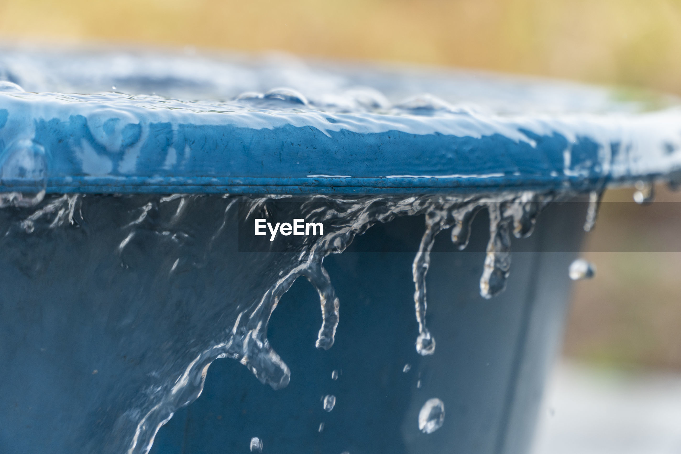 CLOSE-UP OF FROZEN WATER IN WINTER
