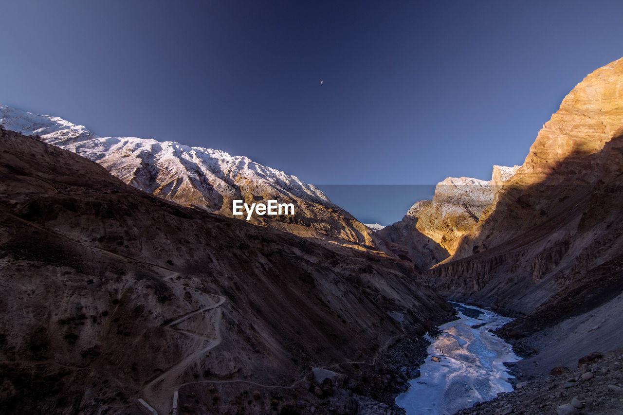 Snowcapped Mountain Peak Against Clear Sky