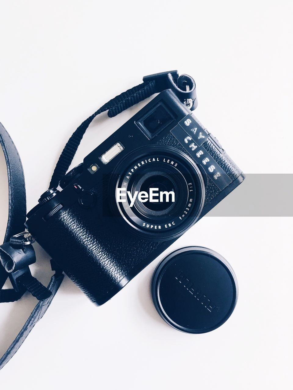 photography themes, technology, studio shot, white background, camera - photographic equipment, indoors, photographic equipment, still life, close-up, black color, no people, lens - optical instrument, digital camera, camera, high angle view, equipment, cut out, retro styled, copy space, slr camera