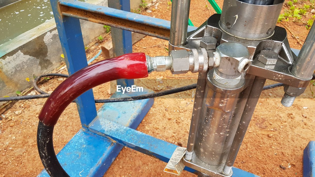 metal, no people, day, pipe - tube, connection, valve, close-up, pipeline, high angle view, industry, fuel and power generation, machinery, control, outdoors, water pump, rusty, machine valve, equipment, nature, technology, outdoor play equipment