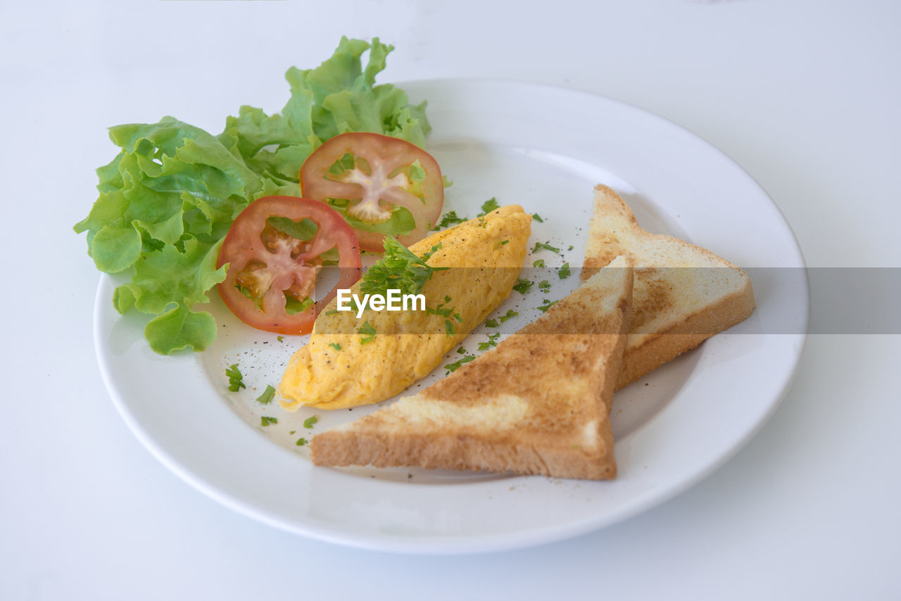 plate, food, ready-to-eat, food and drink, freshness, healthy eating, bread, wellbeing, vegetable, serving size, indoors, close-up, meal, still life, no people, high angle view, fruit, table, indulgence, lettuce, breakfast, garnish, snack, temptation