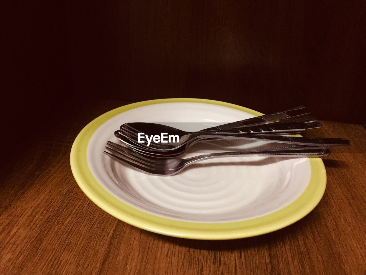 kitchen utensil, eating utensil, plate, table, fork, indoors, still life, food, food and drink, spoon, close-up, no people, sweet food, wood - material, household equipment, indulgence, sweet, dessert, high angle view, freshness, temptation, crockery, table knife, setting