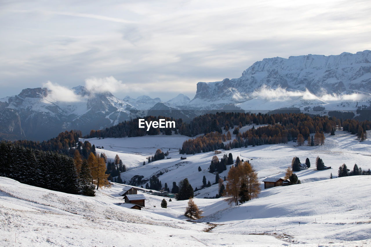 winter, snow, cold temperature, sky, cloud - sky, mountain, beauty in nature, scenics - nature, tranquil scene, tranquility, tree, nature, environment, non-urban scene, mountain range, day, plant, land, landscape, no people, outdoors, snowcapped mountain